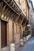 stock photo of ferrara  - Medieval street in Ferrara with a Trattoria