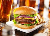 stock photo of hamburger  - hamburger with fries and beer shot in panorama style - JPG