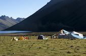 stock photo of nomads  - Nomad tents and camp trekkers at a lake in Tibet Amdo - JPG