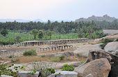 stock photo of karnataka  - Ancient ruins of Vijayanagara Empire at sunset blue sky in Hampi - JPG