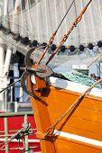 Anchor on the prow of a shrimper's boat at Fedderwardersiel, german North Sea Region