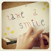 Take a Smile sign with hands - With Instagram effect