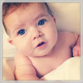 Adorable baby girl taken closeup - With Instagram effect
