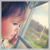 Baby looking out window - With Instagram effect