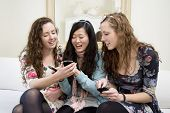 Young women sharing video on cell phone