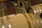 Close up of wooden wine barrels stored in a cellar