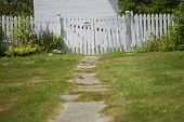 Old Path Leading To White Picket Fence