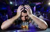 stock photo of addict  - young alcoholic drunk man depressed - JPG