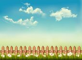 Retro background with a fence, grass, sky and flowers.