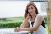 Beautiful Young Redhead Woman Reading Outdoors