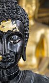 Close Up Half Face Of A Black Buddha