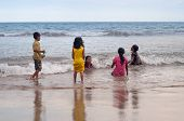 Indonesian Children Swim In The Sea On Tiku Beach