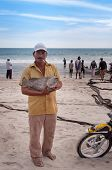 Fisherman With Big Fish On Tiku Beach