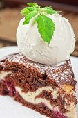 A slice of chocolate cake with ice cream