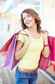 Happy female shopaholic enjoying her shopping