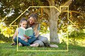Mother and daughter reading a book at park against house outline