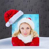 happy festive blonde against grey reindeer pattern