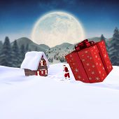 Santa delivering large gift against cute christmas village under huge full moon