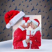 festive couple against grey reindeer pattern