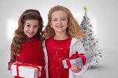 Cute sisters against christmas tree in bright room