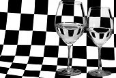 two glasses with water on black and white square background