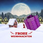 frohe weinhnachten against quaint town with bright moon