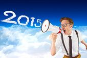 Geeky businessman shouting through megaphone against bright blue sky over clouds