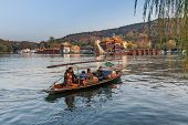 Traditional Chinese Wooden Recreation Boat With Boatman