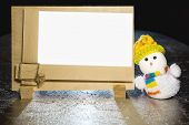 Christmas Snowman Toy And Blank Wooden Frame
