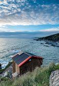 Beach Hut On Cliffs
