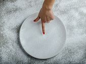 Snowy Plate Background With A Woman Hand