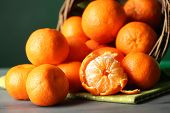 Fresh ripe mandarins in wicker basket, close-up