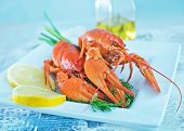 picture of crawfish  - boiled crawfish with fresh lemon on the plate - JPG