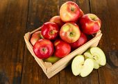 Crate of apples on wooden table background