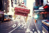 Santa flying his sleigh against blurry new york street
