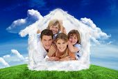 Happy family having fun together against green field under blue sky