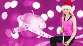 Fit festive young blonde measuring her thigh against pink
