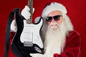 Father Christmas shows a guitar against red background