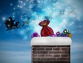 Composite image of santa flying his sleigh against blue sky