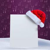 Santa hat on poster against purple reindeer pattern
