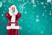 Santa is shocked to camera against green snowflake background