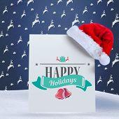Christmas message against blue reindeer pattern