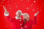 Festive couple against red background