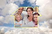 Close up of a family looking at a photo album against blue sky with white clouds