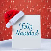 Feliz navidad against red reindeer pattern