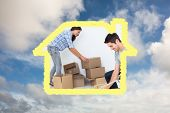 Woman and man wrapping boxes against blue sky with white clouds