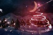 Cute christmas village at night against christmas light design
