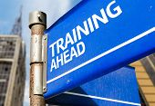 Training Ahead blue road sign