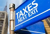 Taxes Next Exit blue road sign