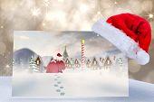 Santa delivery presents to village against shimmering light design on grey
